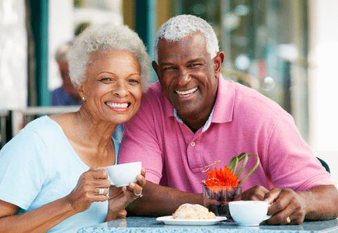 old couple having a cup of coffee