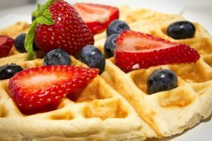 waffle with strawberry and blueberry on top