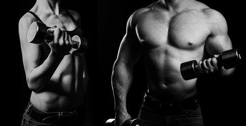 Strong man and strong woman posing on a black background
